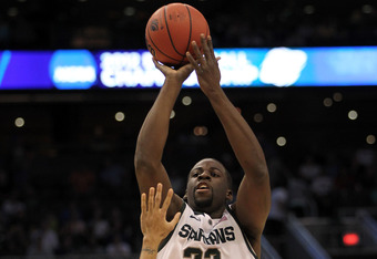 PHOENIX, AZ - MARCH 22:  Draymond Green #23 of the Michigan State Spartans shoots over Peyton Siva #3 of the Louisville Cardinals during the 2012 NCAA Men's Basketball West Regional Semifinal game at US Airways Center on March 22, 2012 in Phoenix, Arizona