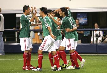 ARLINGTON, TX - JUNE 05:  Javier Hernandez #14 of Mexico is congratulated by Rafel Marquez #4, Aldo De Nigris, Efrain Juarez #9 and Efrain Juarez #16 for scoring a penalty kick goal against El Salvador during the match against El Salvador at the ONCACAF G