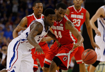 NEW ORLEANS, LA - MARCH 31:  Elijah Johnson #15 of the Kansas Jayhawks and William Buford #44 of the Ohio State Buckeyes go after the ball in the second half during the National Semifinal game of the 2012 NCAA Division I Men's Basketball Championship at t