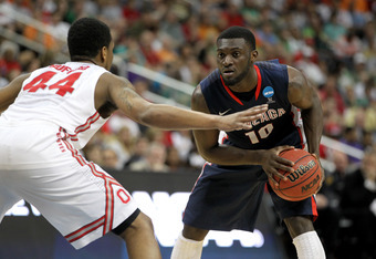 PITTSBURGH, PA - MARCH 17:  Guy Landry Edi #10 of the Gonzaga Bulldogs looks to pass in the second half against William Buford #44 of the Ohio State Buckeyes during the third round of the 2012 NCAA Men's Basketball Tournament at Consol Energy Center on Ma