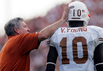 COLLEGE STATION, TX - NOVEMBER 25:  Head coach Mack Brown of the Texas Longhorns pats Vince Young #10 on the head during play against the Texas A&M Aggies on November 25, 2005 at Kyle Field in College Station, Texas.  The Longhorns defeated the Aggies 40-