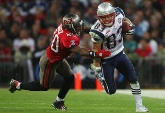 LONDON, ENGLAND - OCTOBER 25:  Wes Welker (#83) of the New England Patriots is tackled by Ronde Barber (#20) of Tampa Bay Buccaneers  during the NFL International Series match between New England Patriots and Tampa Bay Buccaneers at Wembley Stadium on Oct