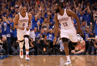OKLAHOMA CITY, OK - MAY 31:  (R-L) James Harden #13 reacts after making a three-pointer alongside teammate Russell Westbrook #0 of the Oklahoma City Thunder in the first half against the San Antonio Spurs in Game Five of the Western Conference Finals of t