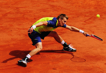 PARIS, FRANCE - MAY 31:  Jarkko Nieminen of Finland plays a forehand during his men's singles second round match against Andy Murray of Great Britain during day five of the French Open at Roland Garros on May 31, 2012 in Paris, France.  (Photo by Mike Hew