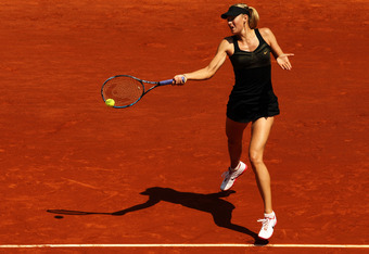 PARIS, FRANCE - MAY 29:  Maria Sharapova of Russia plays a forehand in her women's singles first round match against Alexandra Cadantu of Romania during day 3 of the French Open at Roland Garros on May 29, 2012 in Paris, France.  (Photo by Matthew Stockma