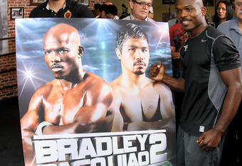 LOS ANGELES, CA - MAY 29:  Timothy Bradley stands in front of a placard advertising Bradley Paquiao 2, which would happen if he wins their upcoming fight in June, at a media workout  at Fortune Gym on May 29, 2012 in Los Angeles, California.  The workout