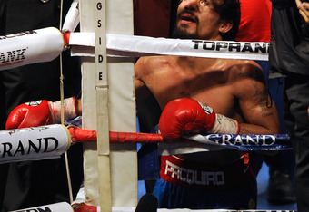 LAS VEGAS, NV - NOVEMBER 12:  Boxer Manny Pacquiao prays in the corner of the ring after his WBO world welterweight title fight against Juan Manuel Marquez at the MGM Grand Garden Arena November 12, 2011 in Las Vegas, Nevada. Pacquiao retained his title w