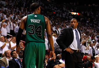 MIAMI, FL - MAY 30:  Doc Rivers of the Boston Celtics looks on as Paul Pierce #34 walks towards the bench after he fouled out in the second half against the Miami Heat in Game Two of the Eastern Conference Finals in the 2012 NBA Playoffs on May 30, 2012 a