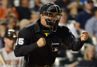 DENVER, CO - MAY 31:  Homeplate Umpire Tim Timmons calls out a batter on strikes between the Houston Astros and the Colorado Rockies at Coors Field on May 31, 2012 in Denver, Colorado.  (Photo by Doug Pensinger/Getty Images)