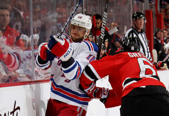 Gaborik, seen here checked by New Jersey's Andy Greene, was clearly feeling the pain during the Rangers' playoff run.