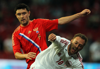 Yuri Zherkov (left) moves from his usually left wing spot to left back for Russia.