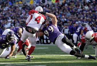 BALTIMORE, MD - OCTOBER 30:  Paul Kruger #99 of the Baltimore Ravens sacks  Kevin Kolb #4 of the Arizona Cardinals during the second half at M&T Bank Stadium on October 30, 2011 in Baltimore, Maryland. The Baltimore won 30-27.  (Photo by Rob Carr/Getty Im