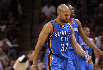 SAN ANTONIO, TX - MAY 29:  Derek Fisher #37 and Kevin Durant #35 of the Oklahoma City Thunder react as they walk back to the bench in the fourth quarter while taking on the San Antonio Spurs in Game Two of the Western Conference Finals of the 2012 NBA Pla