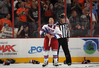 PHILADELPHIA, PA - SEPTEMBER 26: Sean Avery #16 of the New York Rangers checks the scoreboard following an altercation with the Philadelphia Flyers during an NHL preseason game at Wells Fargo Center on September 26, 2011 in Philadelphia, Pennsylvania.  (P