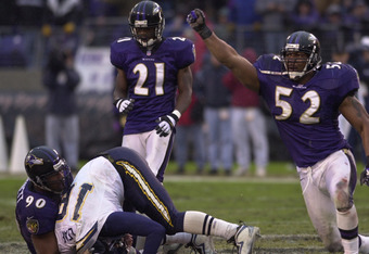 10 Dec 2000:  Ray Lewis #52 of the Baltimore Ravens celebrates as teammate Rob Burnett #90 sacks Ryan Leaf #16 of the San Diego Chargers at PSINet Stadium in Baltimore, Maryland. DIGITAL IMAGE Mandatory Credit: Doug Pensinger/ALLSPORT