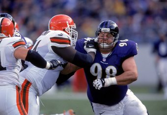 26 Nov 2000:  Tony Siragusa #98 of the Baltimore Ravens goes head to head against James Brown #74 of the Cleveland Browns during the game at the PSINET Stadium in Baltimore, Maryland. The Ravens defeated the Browns 37-7.Mandatory Credit: Doug Pensinger  /