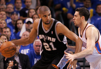 OKLAHOMA CITY, OK - MAY 31:  Tim Duncan #21 of the San Antonio Spurs posts up Nick Collison #4 of the Oklahoma City Thunder in the second quarter in Game Five of the Western Conference Finals of the 2012 NBA Playoffs at Chesapeake Energy Arena on May 31,