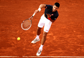 PARIS, FRANCE - JUNE 01:  Novak Djokovic of Serbia serves during his men's singles third round match against Nicolas Devilder of France during day six of the French Open at Roland Garros on June 1, 2012 in Paris, France.  (Photo by Matthew Stockman/Getty