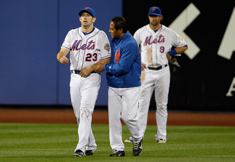 Mike Baxter is helped off the field after entering Mets lore with his incredible catch against the wall to preserve the no hitter