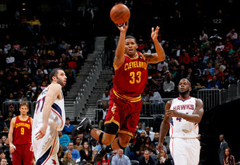 ATLANTA, GA - JANUARY 21:  Alonzo Gee #33 of the Cleveland Cavaliers attemps a halfcourt shot as time expires in the first half between Vladimir Radmanovic #77 and Ivan Johnson #44 of the Atlanta Hawks at Philips Arena on January 21, 2012 in Atlanta, Geor