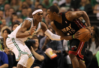 BOSTON, MA - JUNE 01:  Mario Chalmers #15 of the Miami Heat looks to pass the ball against Rajon Rondo #9 of the Boston Celtics in Game Three of the Eastern Conference Finals in the 2012 NBA Playoffs on June 1, 2012 at TD Garden in Boston, Massachusetts.