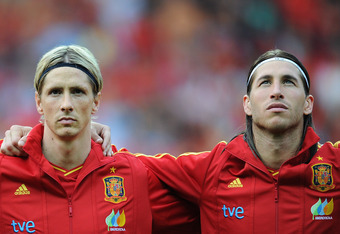 BERN, SWITZERLAND - MAY 30: Fernando Torres (L) of Spain stands with his teammate Sergio Ramos as they listen to their countries national anthem during the international friendly match between Spain and Korea Republic on May 30, 2012 in Bern, Switzerland.