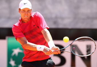 ROME, ITALY - MAY 17:  Tomas Berdych of Czech Republic plays a backhand in his match against Nicolas Almagro of Spain during day six of the Internazionali BNL d'Italia 2012 Tennis on May 17, 2012 in Rome, Italy.  (Photo by Julian Finney/Getty Images)