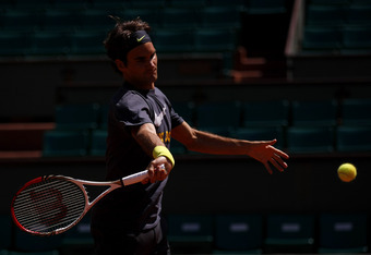 PARIS, FRANCE - MAY 25:  Roger Federer of Switzerland hits a forehand during a practice session ahead of the French Open at Roland Garros on May 25, 2012 in Paris, France.  (Photo by Dan Istitene/Getty Images)