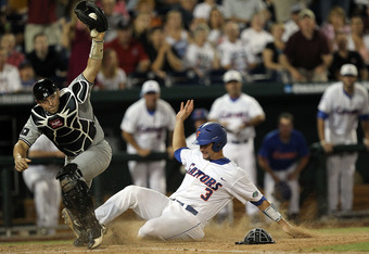 OMAHA, NE - JUNE 27:  Catcher Robert Beary #4 of the South Carolina Gamecocks makes the out against Mike Zunino #3 of the Florida Gators in the 9th inning during game 1 of the men's 2011 NCAA College Baseball World Series at TD Ameritrade Park Omaha on Ju