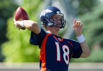 ENGLEWOOD, CO - MAY 21:  Peyton Manning #18 of the Denver Broncos throws during organized team activities at Dove Valley on May 21, 2012 in Englewood, Colorado. (Photo by Justin Edmonds/Getty Images)