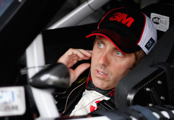 DOVER, DE - JUNE 01:  Greg Biffle, driver of the #16 3M/Heiland (EMD) Ford, sits in his car in the garage area during practice for the NASCAR Sprint Cup Series FedEx 400 benefiting Autism Speaks at Dover International Speedway on June 1, 2012 in Dover, De