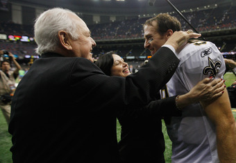 NEW ORLEANS, LA - SEPTEMBER 18:   Drew Brees #9 of the New Orleans Saints celebrates with team owner Tom Benson after defeating the Chicago Bears 30-13 at Louisiana Superdome on September 18, 2011 in New Orleans, Louisiana.  (Photo by Chris Graythen/Getty