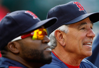 BALTIMORE, MD - MAY 22:  Manager Bobby Valentine (R) and David Ortiz #34 of the Boston Red Sox look on during batting practice before the start of the Red Sox game against the Baltimore Orioles at Oriole Park at Camden Yards on May 22, 2012 in Baltimore,