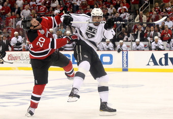 NEWARK, NJ - JUNE 02: Jordan Nolan #71 of the Los Angeles Kings makes contact with Ryan Carter #20 of the New Jersey Devils during Game Two of the 2012 NHL Stanley Cup Final at the Prudential Center on June 2, 2012 in Newark, New Jersey.  (Photo by Elsa/G