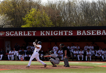 PISCATAWAY, NJ - APRIL 14:  Jeff Melillo #1 of the Rutgers Scarlet Knights fouls out in the bottom of the fifth inning against the West Virginia Mountaineers during their Big East Conference Game at Bainton Field on on April 14, 2012 in Piscataway, New Je