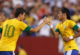 LANDOVER, MD - MAY 30: Neymar #11 (R) of Brazil celebrates with teammate Oscar #10 after Neymar scored the first goal against USA during an International friendly game at FedExField on May 30, 2012 in Landover, Maryland.  (Photo by Rob Carr/Getty Images)