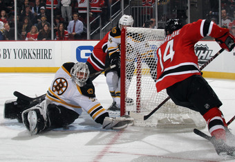 NEWARK, NJ - JANUARY 19: Tim Thomas #30 of the Boston Bruins makes the second period save as Adam Henrique #14 of the New Jersey Devils looks for a rebound at the Prudential Center on January 19, 2012 in Newark, New Jersey.  (Photo by Bruce Bennett/Getty