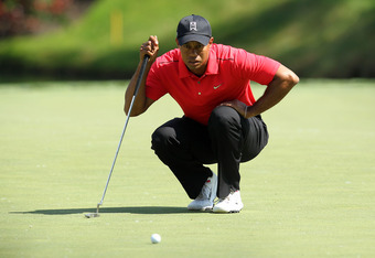 DUBLIN, OH - JUNE 03:  Tiger Woods lines up his birdie putt on the par 3 12th hole during the final round of the Memorial Tournament presented by Nationwide Insurance at Muirfield Village Golf Club on June 3, 2012 in Dublin, Ohio.  (Photo by Andy Lyons/Ge