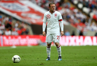 LONDON, ENGLAND - JUNE 02:  Wayne Rooney of England prepares to take a free kick during the international friendly match between England and Belgium at Wembley Stadium on June 2, 2012 in London, England.  (Photo by Clive Mason/Getty Images)