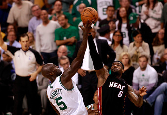 BOSTON, MA - JUNE 03:  Kevin Garnett #5 of the Boston Celtics goes up for a jumpball against LeBron James #6 of the Miami Heat in Game Four of the Eastern Conference Finals in the 2012 NBA Playoffs on June 3, 2012 at TD Garden in Boston, Massachusetts. NO