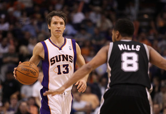 PHOENIX, AZ - APRIL 25:  Steve Nash #13 of the Phoenix Suns moves the ball upcourt during the NBA game against the San Antonio Spurs at US Airways Center on April 25, 2012 in Phoenix, Arizona.  The Spurs defeated the Suns 110-106.  NOTE TO USER: User expr