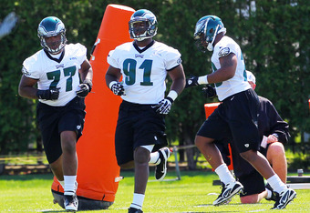 PHILADELPHIA, PA - MAY 12: Twyon Martin #77 and Fletcher Cox #91 of the Philadelphia Eagles run drills during rookie minicamp at their practice facility on May 12, 2012 in Philadelphia, Pennsylvania. (Photo by Rich Schultz/Getty Images)