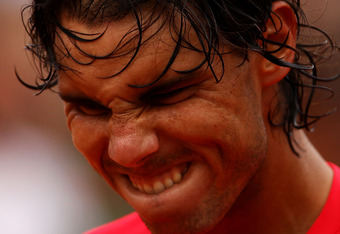 PARIS, FRANCE - JUNE 02:  Rafael Nadal of Spain celebrates victory in his men's singles third round match against Eduardo Schwank of Argentina during day seven of the French Open at Roland Garros on June 2, 2012 in Paris, France.  (Photo by Clive Brunskil