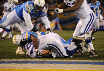 SAN DIEGO - JANUARY 03:  Quarterback Peyton Manning #18 of the Indianapolis Colts is sacked by linebacker Tim Dobbins #51 of the San Diego Chargers during the AFC Wild Card Game on January 3, 2009 at Qualcomm Stadium in San Diego, California.  (Photo by H