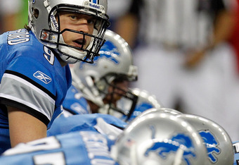 DETROIT, MI - NOVEMBER 24:  Quarterback Matthew Stafford #9 of the Detroit Lions under center in the first quarter against the Green Bay Packers during the Thanksgiving Day game at Ford Field on November 24, 2011 in Detroit, Michigan.  (Photo by Gregory S