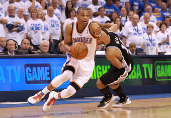 OKLAHOMA CITY, OK - JUNE 02:  Russell Westbrook #0 of the Oklahoma City Thunder drives on Gary Neal #14 of the San Antonio Spurs in the fourth quarter in Game Four of the Western Conference Finals of the 2012 NBA Playoffs at Chesapeake Energy Arena on Jun