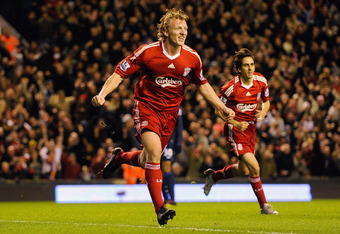 LIVERPOOL, ENGLAND - DECEMBER 13:  Dirk Kuyt of Liverpool celebrates scoring the opening goal during the Barclays Premier League match between Liverpool and Arsenal at Anfield on December 13, 2009 in Liverpool, England.  (Photo by Michael Regan/Getty Imag