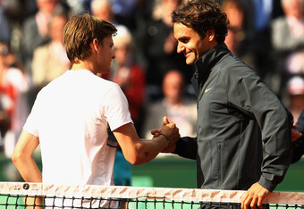 PARIS, FRANCE - JUNE 03:  Roger Federer of Switzerland shakes hands with David Goffin of Belgium after their men's singles fourth round match during day 8 of the French Open at Roland Garros on June 3, 2012 in Paris, France.  (Photo by Matthew Stockman/Ge