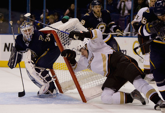 ST. LOUIS, MO. - NOVEMBER 21:  Kent Huskins #40 of the Anaheim Ducks is pushed into the net against Manny Legace #34 of the the St. Louis Blues at Scottrade Center on November 21, 2008 in St. Louis, Missouri.  The Blues beat the Ducks 3-2.  (Photo by Dili
