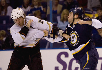 ST. LOUIS, MO. - NOVEMBER 21:  Brad May #24 of the Anaheim Ducks fights Cam Janssen #55 of the St. Louis Blues at Scottrade Center on November 21, 2008 in St. Louis, Missouri.  (Photo by Dilip Vishwanat/Getty Images)